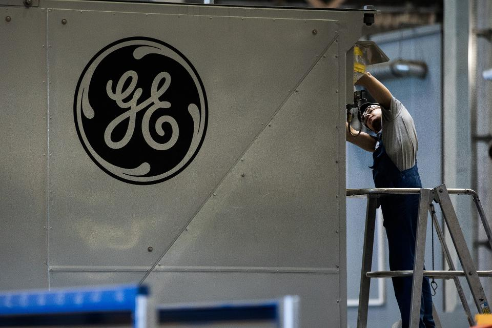 GE logo at plant in Hungary, 2017, Bloomberg