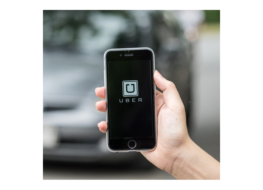 hand holding phone with uber app